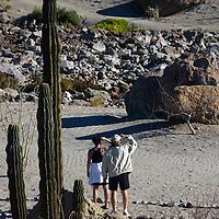 Mexico, Baja California Sur, Loreto. Couple at Villa del Palmar Loreto golf resort and spa.