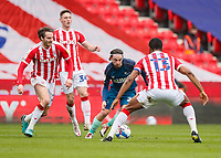Derby County's Patrick Roberts brings the ball forward under pressure from Nick Powell, John Obi Mikel and Jordan Thompson<br /> <br /> Photographer Lee Parker/CameraSport<br /> <br /> The EFL Sky Bet Championship - Stoke City v Derby County - Saturday 20th March 2021 - bet365 Stadium - Stoke-on-Trent<br /> <br /> World Copyright © 2021 CameraSport. All rights reserved. 43 Linden Ave. Countesthorpe. Leicester. England. LE8 5PG - Tel: +44 (0) 116 277 4147 - admin@camerasport.com - www.camerasport.com