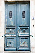Typical quaint house with weatherworn door, traditional architecture, St Martin de Re, Ile de Re, France
