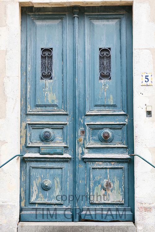 Typical quaint house with weatherworn door, traditional architecture, St Martin de Re, Ile de Re, France
