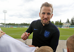 England's Harry Kane signs autographs for fans during the training session at the Spartak Zelenogorsk Stadium, Repino.