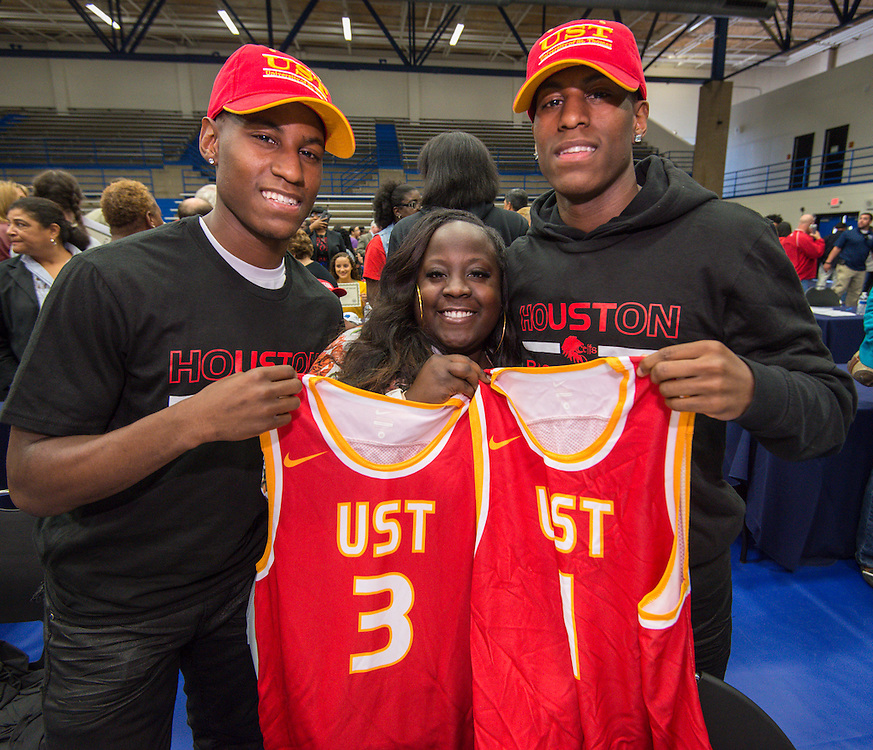 Sam Houston's Kennard and Lennard Robinson show off jerseys for St. Thomas University during National Signing Day ceremonies for Houston ISD student athletes at the Pavilion at Forest Brook Middle School, February 3, 2016.