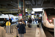 """March, 24th 2020 - Paris, Ile-de-France, France: Montparnasse Train Station virtual empty and passengers wearing masks to prevent the spread of the Coronavirus, during the ninth day of near total lockdown imposed in France. A week after President of France, Emmanuel Macron, said the citizens must stay at home from midday on Tuesday for at least 15 days. He said """"We are at war, a public health war, certainly but we are at war, against an invisible and elusive enemy"""". All journeys outside the home unless justified for essential professional or health reasons are outlawed. Anyone flouting the new regulations is fined. Nigel Dickinson"""
