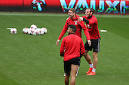 Gareth Bale of Wales ®  jokes with Chris Gunter © during Wales football team training at the Cardiff city Stadium in Cardiff , South Wales on Saturday 8th October 2016, the team are preparing for their FIFA World Cup qualifier home to Georgia tomorrow. pic by Andrew Orchard, Andrew Orchard sports photography
