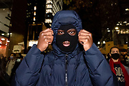 A man poses in Martin Place during a 'Black Lives Matter' rally on 02 June, 2020 in Sydney, Australia. This event was organised to rally against aboriginal deaths in custody in Australia as well as in unity with protests across the United States following the killing of an unarmed black man George Floyd at the hands of a police officer in Minneapolis, Minnesota. (Photo by Steven Markham/ Speed Media)