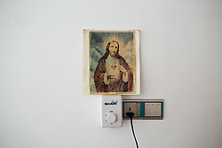 © Licensed to London News Pictures. Hamdaniyah, Iraq. 25/07/2014. A picture of Jesus Christ is seen on the wall of a room inhabited by Iraqi Christians from Mosul in Hamdaniyah, Iraq.<br /> <br /> <br /> <br /> Having taken over Mosul Iraq's second largest city in June 2014, fighter of the Islamic State (formerly known as ISIS) have systematically expelled the cities Christian population. Despite having been present in the city for more than 1600 years, Christians in the city were given just days to either convert to Islam, pay a tax for being Christian or leave; many of those that left were also robbed at gunpoint as they passed through Islamic State checkpoints.. Photo credit : Matt Cetti-Roberts/LNP