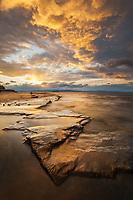 Beautiful clouds illuminated by a setting sun along the shores of Lake Champlain, Burlington Waterfront, Burlington, Vermont