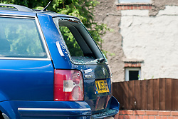 Sheffield 12:56 <br /> Police recover a Blue Vauxhall Passat Estate car with a damaged rear window from the Drive of a House on Deerlands Avenue Parson Cross after a speight of three shootings on three Sheffield Estates Monday Night.<br /> <br /> 22 July 2014<br /> Image © Paul David Drabble <br /> www.pauldaviddrabble.co.uk