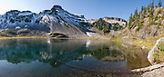 Table Mountain reflects in Upper Bagley Lake, on the Chain Lakes Loop Trail, in Mount Baker Snoqualmie National Forest, Washington, USA. Panorama stitched from 7 images.