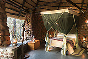 View of inside of bedroom at Stone Camp, Mkhaya Game Reserve, Eswatini