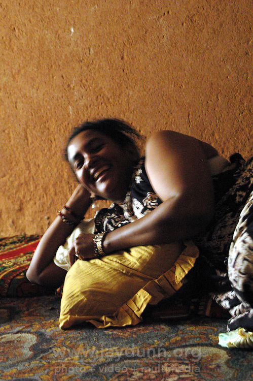 Niger,Agadez,2007. Fatima Ixa relaxes in the welcome cool of the big room at Mohammad Ixa's family home.