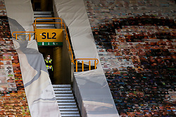 A steward looks on from the stands at Molineux during Wolverhampton Wanderers v Crystal Palace in the Premier League - Mandatory by-line: Robbie Stephenson/JMP - 20/07/2020 - FOOTBALL - Molineux - Wolverhampton, England - Wolverhampton Wanderers v Crystal Palace - Premier League