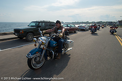 Stu Wiley riding alond the seaside on a ride from Bentley's Saloon in Arundel, Maine back to Laconia, during the annual Laconia Motorcycle Week event. USA. June 17, 2014.  Photography ©2014 Michael Lichter.