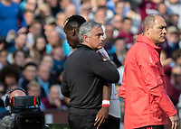 Football - 2018 / 2019 Premier League - West Ham United vs. Manchester United<br /> <br /> Jose Mourinho, mamager of Manchester United, and Paul Pogba (Manchester United) as he is taken off.  Neither looks directly at each other but exchange a touch at the London Stadium<br /> <br /> COLORSPORT/DANIEL BEARHAM