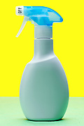 plastic hand held spraying bottle object on yellow green background