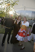 Stefano Pilati , Julia Peyton-Jones and Grayson Perry, The Summer Party sponsored by Yves St. Laurent. Serpentine Gallery. 11 July 2006. . ONE TIME USE ONLY - DO NOT ARCHIVE  © Copyright Photograph by Dafydd Jones 66 Stockwell Park Rd. London SW9 0DA Tel 020 7733 0108 www.dafjones.com
