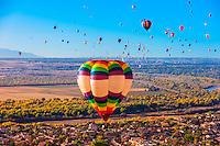Aerial view, hot air balloons flying during the Albuquerque International Balloon Fiesta, Albuquerque, New Mexico USA.