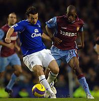 Photo: Paul Greenwood.<br />Everton v Aston Villa. The Barclays Premiership. 11/11/2006. Evertons Simon Davies, left, battles with Villa's Isaiah Osbourne