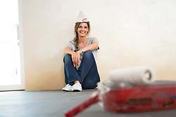 Alone woman decorating new home taking a break