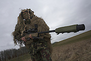 Infantry soldiers of the British Army demonstrate their newest L115A3 sniper rifle on firing ranges of the Support Weapon School, Salisbury Plain, Warminster.