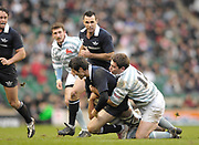 Twickenham. GREAT BRITAIN, Oxford Chris MAHONY is brought to the ground by Steffan Thomas's tackle, during the 2006 Varsity Rugby Match at Twickenham Stadium, England 12.12.2006. [Photo, Peter Spurrier/Intersport-images] Sponsor, Lehman Brothers,