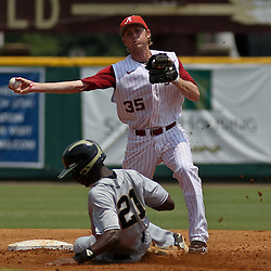 June 05, 2011; Tallahassee, FL, USA; Alabama Crimson Tide second baseman Josh Sanders (35) forces out UCF Knights center fielder Ronnie Richardson  during the second  inning of the Tallahassee regional of the 2011 NCAA baseball tournament at Dick Howser Stadium. Alabama defeated UCF 12-5. Mandatory Credit: Derick E. Hingle