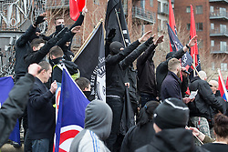 "© Licensed to London News Pictures . FILE PICTURE DATED 21/03/2015 of people giving Neo-Nazi salutes during a "" White Man March "" demonstration organised by the Neo-Nazi group "" National Action "" as today (25th June 2015) National Action supporter Zack Davies has been convicted of the attempted murder of the attempted murder of Dr Sarandar Bhambra . Photo credit : Joel Goodman/LNP"