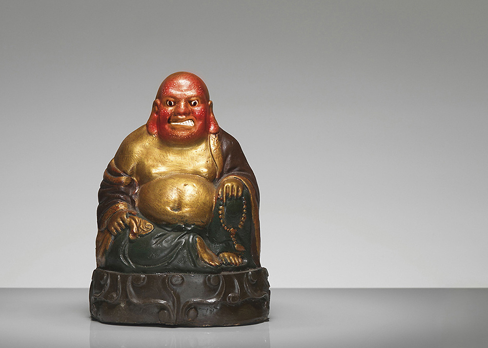 Buddah satue with red head