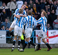 Photo. Glyn Thomas.<br /> Huddersfield Town v Hull City. Nationwide Division 3.<br /> The Alfred McAlpine Stadium, Huddersfield. 15/11/03.<br /> Huddersfield's Andrew Booth (Top) leaps high as he is mobbed by teammates after scoring his side's second goal in the first half.