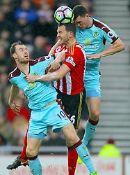 Burnley's Ashley Barnes (left) and Sunderland's John O'Shea and Burnley's Michael Keane battle for the ball