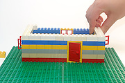 Lego House construction process on white background