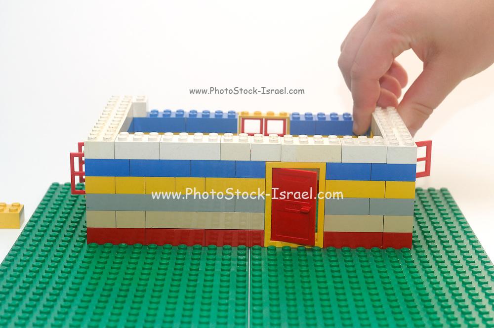 Lego House construction process on white background