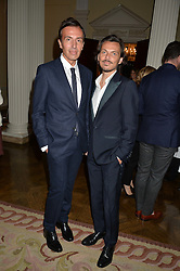 Left to right, JOSEPH VELOSA and MATTHEW WILLIAMSON at a party to kick off London Fashion Week hosted by US Ambassador Matthew Barzun and Mrs Brooke Brown Barzun with Alexandra Shulman in association with J.Crew hrld at Winfield House, Regent's Park, London on 18th September 2015.
