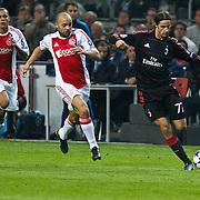 NLD/Amsterdam/20100928 - Champions Leaguewedstrijd Ajax - AC Milan, Zlatan Ibrahimovic in duel met Demy de Zeeuw