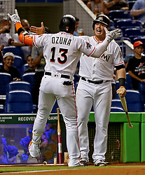 May 30, 2017 - Miami, FL, USA - The Miami Marlins' Marcell Ozuna (13) celebrates his second-inning home run with teammate Justin Bour against the Philadelphia Phillies at Marlins Park in Miami on Tuesday, May 30, 2017. The Marlins won, 7-2. (Credit Image: © Patrick Farrell/TNS via ZUMA Wire)