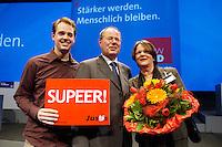 11 FEB 2005, BOCHUM/GERMANY:<br /> Peer Steinbrueck (M), SPD, Ministerpraesident NRW, mit seiner Frau Gertrud Steinbrueck (R) und seinem Sohn Johannes Steinbrueck (L), nach seiner Wahl zum Spitzenkandidaten der Landtagswahl 2005, Landesdelegiertenkonferenz der SPD Nordrhein-Westfalen, RuhrCongress Bochum<br /> IMAGE: 20050211-02-111<br /> KEYWORDS: Peer Steinbrück, Blumen, Gertrud Steinbrück, Johannes Steinbrück, Super, Schild, Familie, Family
