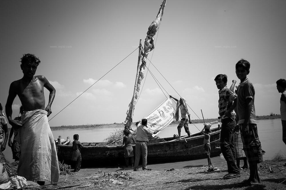 IEC materail is put up on a boat operating on the Ganga river near Patna, Bihar