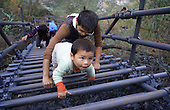 Ladder Makes Safer Way for students to climb cliff