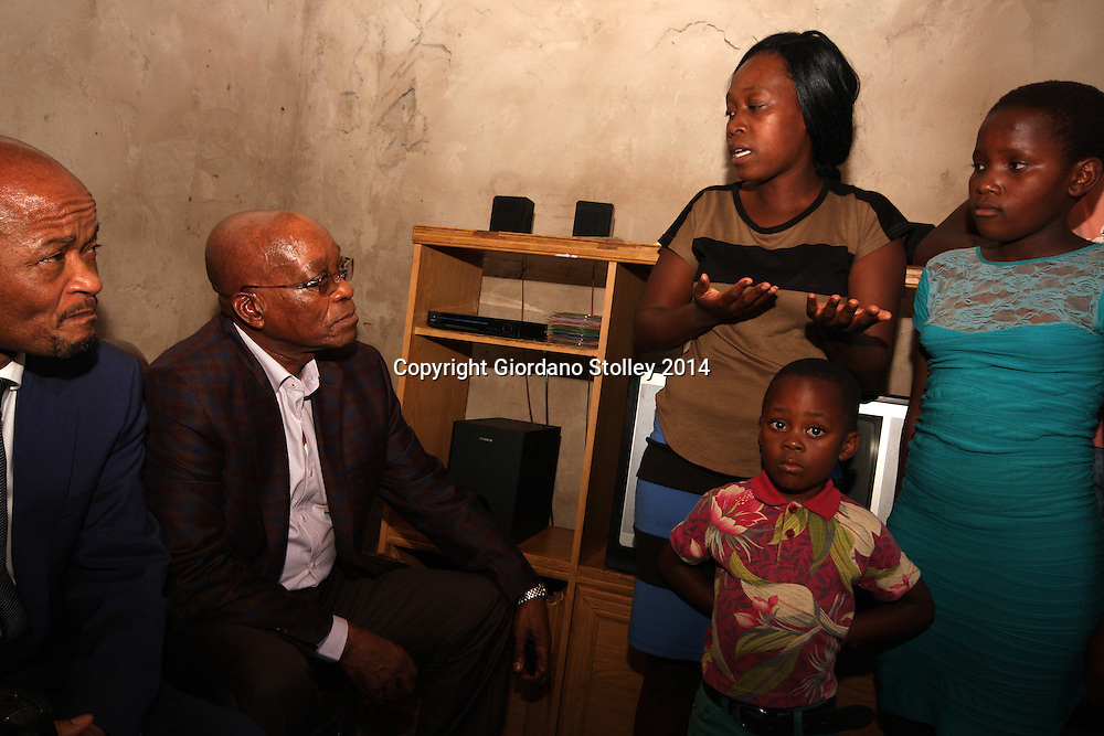 PIETERMARITZBURG - 30 September 2014 - KwaZulu-Natal premier Senzo Mchunu and South African president Jacob Zuma listen to Zandile Ngcobo explain the hardships of life in Pietermaritzburg's Imbali township. The 23-year old Ngcobo lost her parents and has to look after her son Sisanda, 4, as well as her siblings Minenhle Ngcobo, 12 (blue dress), and Ncinci Ngcobo 9orange t-shirt). Picture: Allied Picture Press/APP