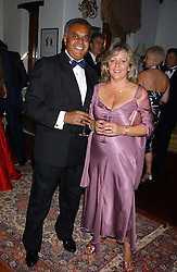 KEVIN SMITH and his wife JANET at a charity dinner hosted by Jennie Hallam-Peel to promote the London Debutante Season held at her home Somerhill, Rowdean Crescent, Brighton on 12th September 2004.