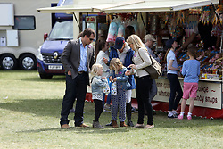 Peter and Autumn Phillips with daughters Savannah and Isla at the Royal Windsor Horse Show, which is held in the grounds of Windsor Castle in Berkshire.