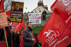 "© Licensed to London News Pictures . 08/03/2014 . York , UK . A group of protesters hang a banner that reads "" Welcome to Traitors Gate "" and a Nick Clegg effigy from York City Wall . A TUC protest march against the Liberal Democrat and Conservative coalition government passes by the Barbican Centre in York . The second day of the Liberal Democrat Spring Conference today (Saturday 8th March 2014) . Photo credit : Joel Goodman/LNP"