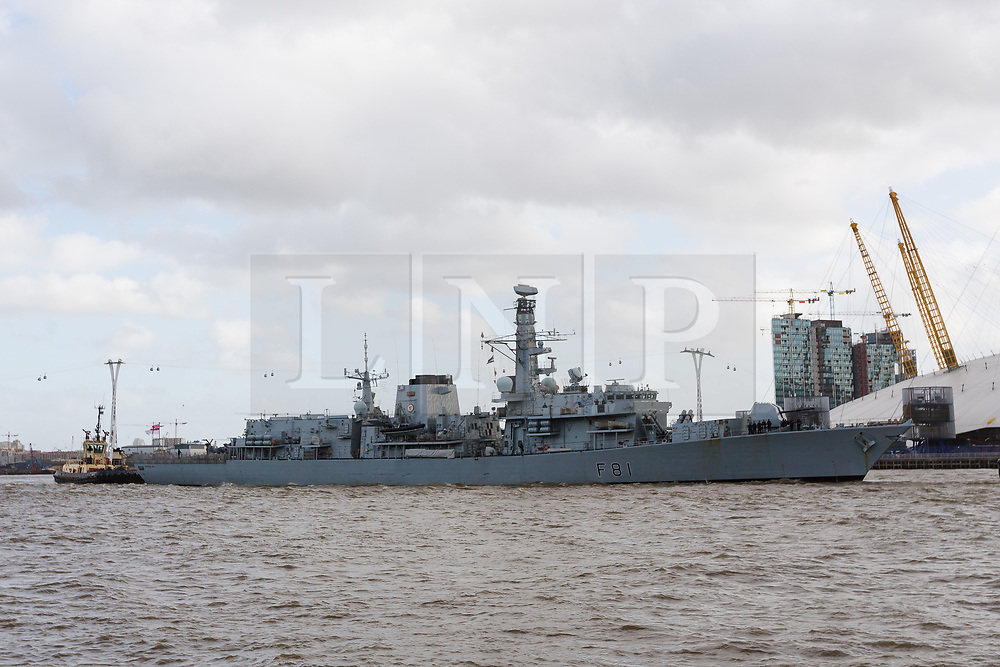 © Licensed to London News Pictures. 21/10/2017. LONDON, UK.  HMS Sutherland, a Type 23 frigate of the British Royal Navy travels on the River Thames under the Cable Car, approaching West India Dock, Canary Wharf for Trafalgar Day celebrations. The ship is celebrating the 20th anniversary of her commissioning this year and will be visited by Her Majesty the Queen next week..  Photo credit: Vickie Flores/LNP