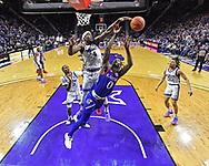 Makol Mawien #14 of the Kansas State Wildcats blocks the shot of Marcus Garrett #0 of the Kansas Jayhawks during the second half at Bramlage Coliseum on February 29, 2020 in Manhattan, Kansas.