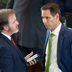 Texas Senate action on Monday, May 17, 2021 showing Sen. Nathan Johnson, r, talking with Bryan Hughes, R-Mineola.