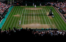 Kevin Anderson (bottom of court) celebrates beating John Isner after his 7-6 (8/6) 6-7 (5/7) 6-7 (9/11) 6-4 26-24 win in the longest semi-final in the tournamentís history on day eleven of the Wimbledon Championships at the All England Lawn Tennis and Croquet Club, Wimbledon.