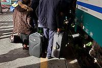 Passengers get on the last Trinacria train. The Trinacria express train is a historical train from Palermo, Sicily, to Milan, symbol of the emigration from South to the North.  From December 11th 2011 16 train connecting Southern Italy to the North will be cancelled by Trenitalia, the state-owned train operator in Italy. ### I passeggeri salgono sull'ultimo treno Trinacria. Il Trinacria è un treno storico che ha collegato Palermo e Milano, simbolo dell'emigrazione verso Nord. Dall'11 dicembre 2011 16 treni che collegano il Sud al Nord Italia verranno soppressi da Trenitalia.