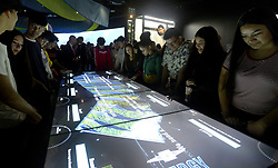 May 24, 2019 - Long Beach, California, U.S. - Lakewood High School students at an interactive game table learning about energy for CaliforniaÃ•s growing population.  The Pacific Visions wing of the Aquarium of the Pacific which is now officially open to the public in Long Beach on Friday, May 24, 2019. (Credit Image: © Brittany Murray/SCNG via ZUMA Wire)