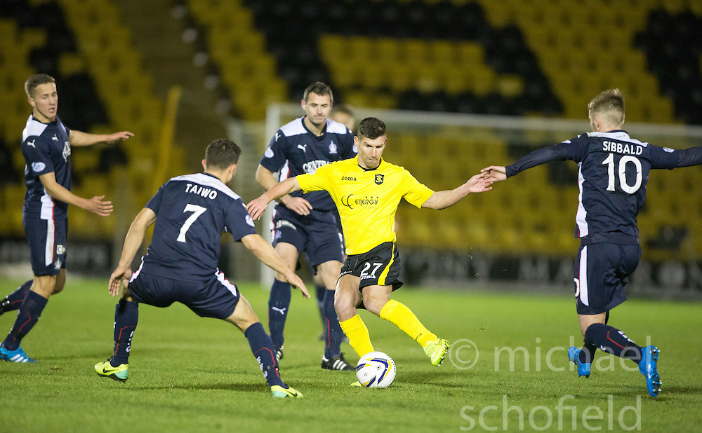 Livingston Mark Burchill surrounded by Falkirk. <br /> Livingston 0 v 1 Falkirk, Scottish Championship played13/12/2014 at The Energy Assets Arena.