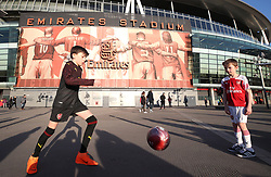 Young Arsenal fans playing football outside the ground before the game during the UEFA Europa League round of 32 second leg match at the Emirates Stadium, London.